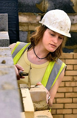 young woman bricklayer